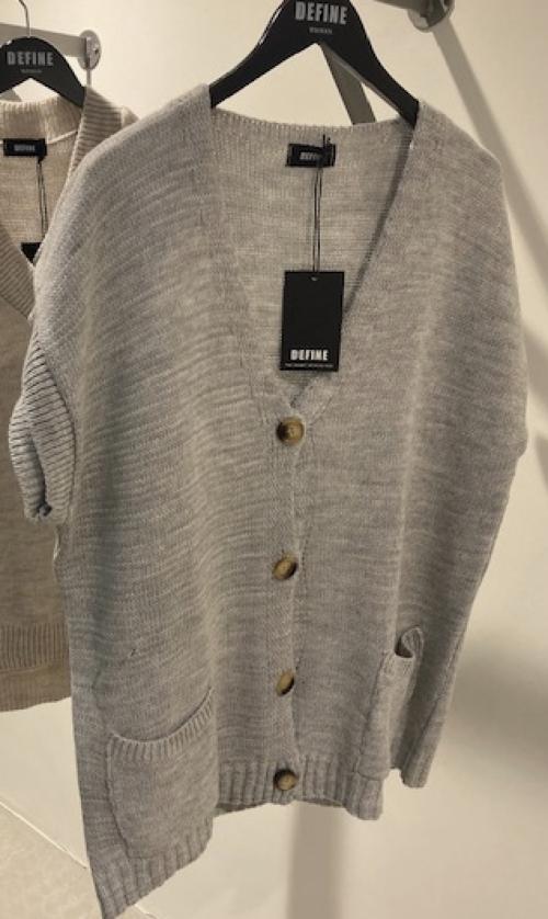 Define strikket vest med lommer